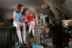 The young sisters with the book of fairy tales from the framing segments of the film.