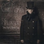Numan poses in Victorian garb next to a chalkboard with the album title.