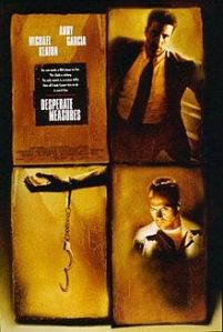 Stars Michael Keaton and Andy Garcia are pictured with an arm handcuffed to nothing in the movie poster.