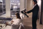 Patrick Bateman lines up a headshot in a still from the film.