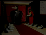 The bokor and his assistant laying out bird masks in the ceremonial chamber in a still from the film.
