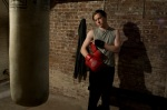 Caleb Steinmeyer eyes a punching bag in this still from the film.