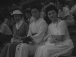 The ladies of the film take in a day of racing in a still from the film.