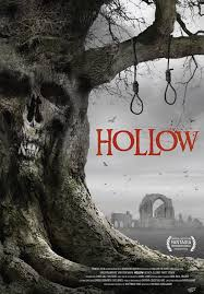 A tree with a skull face in the bark and two hangman's nooses dangling from the branches decorates the movie poster.