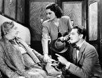 Lockwood and Redgrave implore Dame May Whitty in a still from the film.