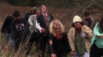 A line of the walking dead descend on our heroes in this still from the film.