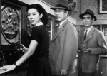 Three of the film's principals (Kogure is missing) meet in a pachinko parlor in this still from the film.