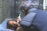 McDowall injects Sha-Ri Pendleton in this still from the film.