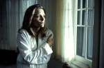 Michelle Pfeiffer gazes out a window in a still from the film.