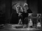 Ernest Thesiger as Pretorius lords it over his minuscule charges in a still from the film.