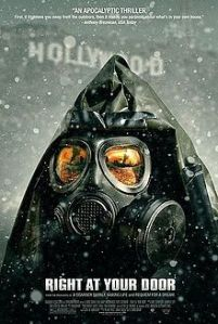 A government official in a camo hazmat suit surrounded by falling snow decorates the movie poster.