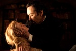 John Cusack and Alice Eve in a clinch in a still from the film.