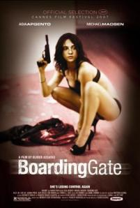 Asia Argento, in an unsurprising state of undress, crouches while clutching a gun on the movie poster.