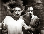 Elsa Lanchester and Colin Clive stare dumbfounded at something in a still from the film.