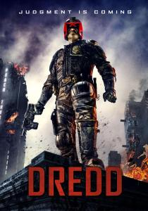 Karl Urban, in full Judge Dredd gear, stands atop a burning building on the movie's poster.