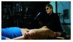 Eric Roberts prepares to make mincemeat of a captive in a still from the film.