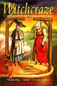 An artist's rendition of two Puritans suspended from the gallows adorns the paperback cover.
