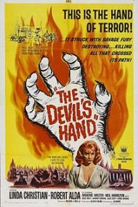 A disembodied hand floats over Linda Christian on the movie poster.