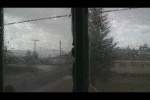 A late still from the film, looking out a window over Butte in the rain.