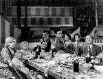 The dinner scene at the climax of the film, containing most of the cast.
