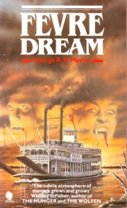 The faces of two vampires appear in the clouds behind a nineteenth-century riverboat on the book's cover.