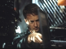 Edward Norton cracks a safe in a still from the film.