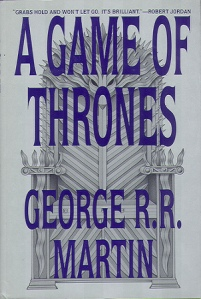 The Iron Throne, on a silver background, decorates the book's cover.