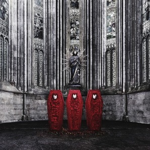 Three red velvet coffins inhabit a huge metal-walled room on the limited-edition album cover.