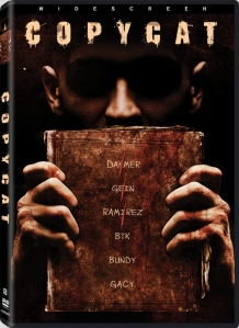 A shadowy figure holds up a book with the names of a number of serial killers on it, some crossed off, on the DVD cover.
