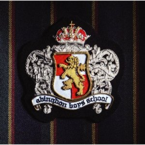 The band's logo, stylized to look like the actual crest of a boys' school, decorates the album cover.