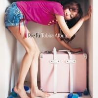 Rie Fu, with suitcase, poses in what may actually be a Tokyo apartment on the album cover.