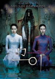 The film's two protagonists haunted by the titular ghost adorn the movie poster.