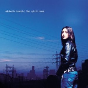 Branch stands, alone, looking over her shoulder at the camera on the album cover.