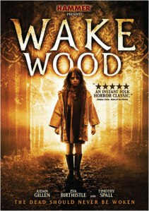 Ella Connolly, in a rain slicker and boots, stands in the woods gazing at the camera on the movie poster.