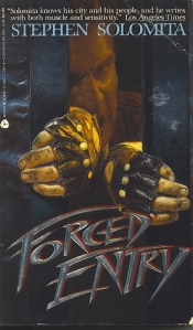 A villain tries to force a door on the cover of the mass market paperback.