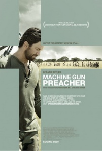 Gerard Butler, framed by a cross, strikes a contemplative pose on the movie poster.