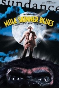 The movie's proposed giant ape-like monster, Beany Anderson standing atop it, adorns the movie poster.