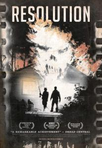 Two people in shadow stand in front of a house with a ghostly face above them in smoke on the DVD cover.