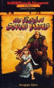 A halfling and an ogre, both not terribly well-drawn, adorn the cover of the book.