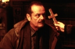 Someone offscreen brandishes a cross at Jack Nicholson in a still from the film.