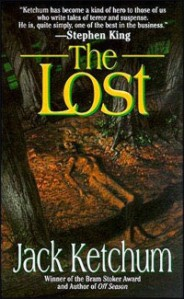 A decaying body barely stands out from the dead leaves on the forest floor on the cover of the book.