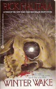 A skull, still with hair, bleeds from one eye socket that reflects the moon on the book's cover.