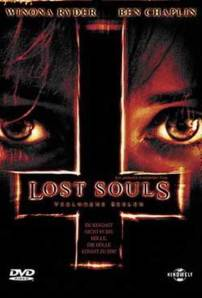 A pair of eyes flank an inverted cross on the movie poster.