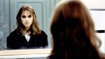 Winona Ryder stares into a mirror in a still from the film.