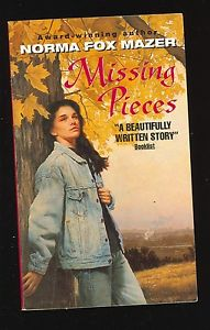 Jessie leans up against a tree looking reflective on the book cover.