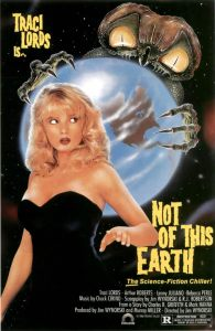 Traci Lords stands in front of Earth, which is locked in the clutches of an alien, on the movie poster.