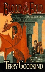 Richard and Kahlan take a look at a dragon on the book's cover.