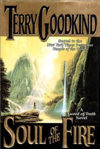 A lone figure stands on a rock outcropping, staring up at a massive waterfall, on the book's cover.