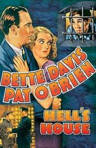 O'Brien and Davis stand staring at Durkin, looking out of a jail cell window, on the movie poster.