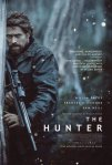 Willem Dafoe, gun cradled in arms, adorns the movie poster.